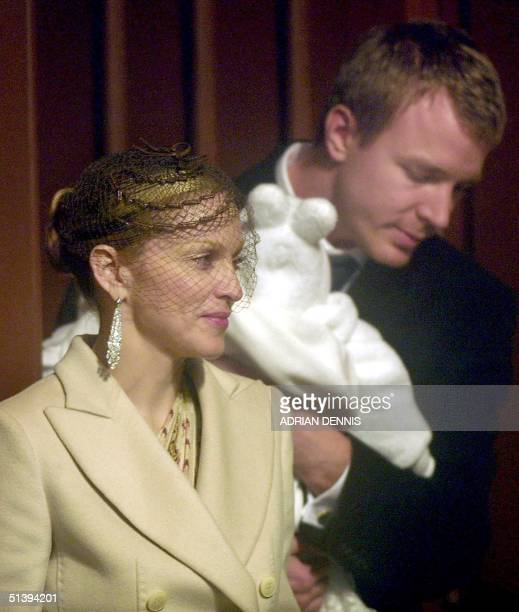US pop star Madonna and British film director Guy Ritchie leave Dornoch Cathedral 21 December 2000 The couple christened their 4month old son Rocco...
