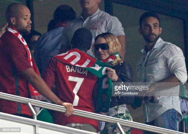 US pop star Madonna and her son David Banda attend the FIFA World Cup 2018 Group B qualifier football match between Portugal and Switzerland at the...