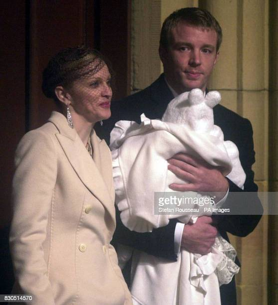 Pop star Madonna and partner Guy Ritchie leave Dornoch Cathedral after having their baby Rocco Christened She was wearing a cream full length coat...