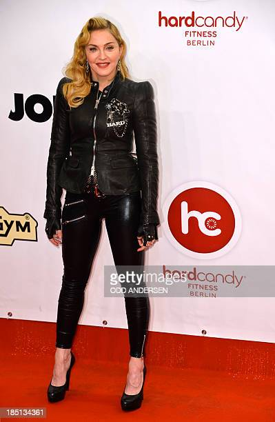 US pop star Madonna poses for photographers on the red carpet on the opening event of the Fitness Center 'Hard Candy' on October 17 2013 in BerlinThe...