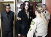 US pop star Michael Jackson arrives with his father Joe Jackson at the Santa Barbara County Courthouse for day 20 of his child molestation trial...