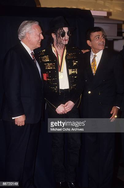 Pop star Michael Jackson chats with radio personality Casey Kasem and another man on May 19 1993 in New York City New York