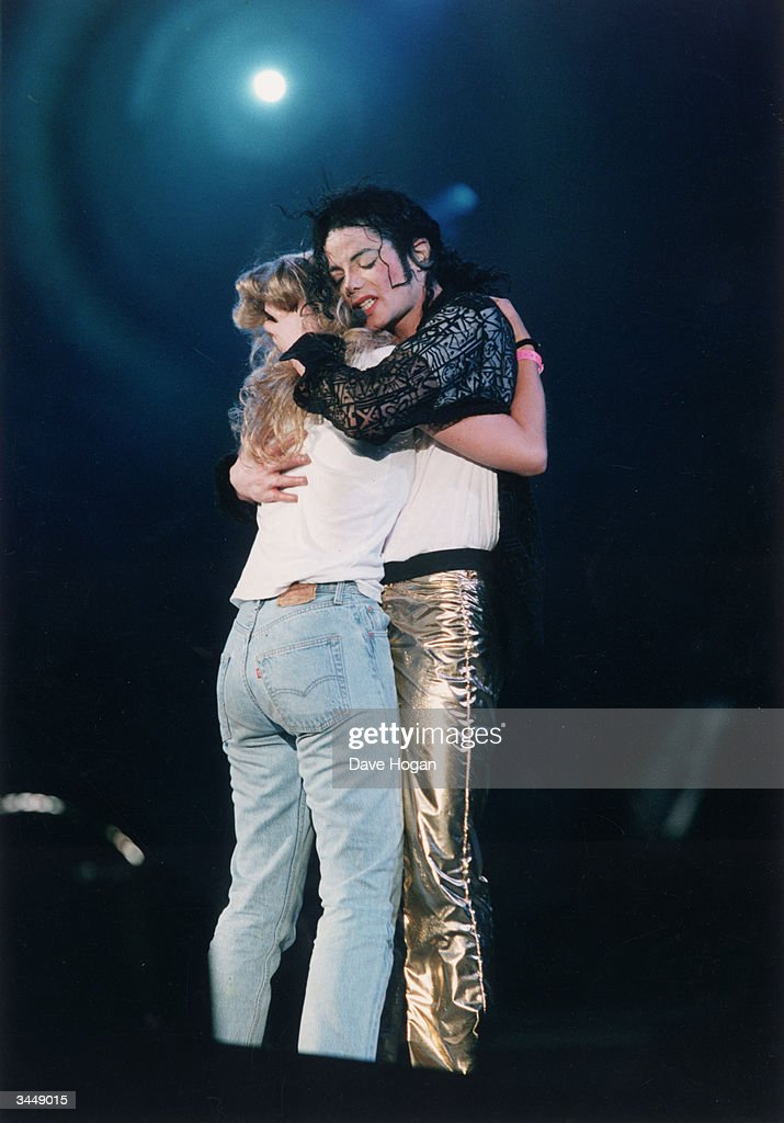Pop star Michael Jackson enriches the life of one lucky fan, circa 2000.