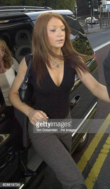 Pop star Nicola Roberts of the group 'Girls Aloud' arrives at Kingston Crown Court to give evidence during the trial of fellow band member Cheryl...