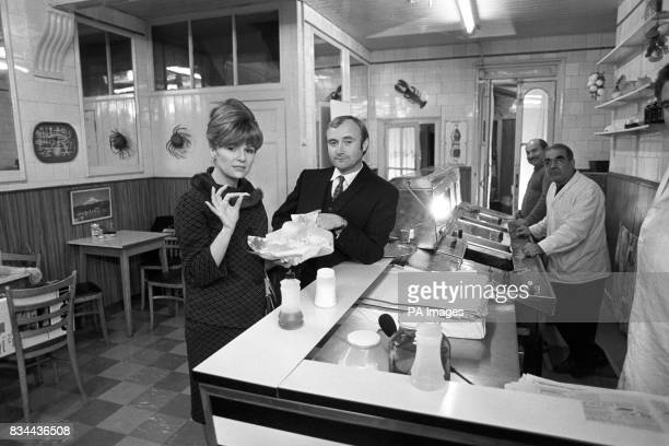 Pop star Phil Collins buys actress Julie Walters an old fashioned take away meal of fish and chips in a cafe in south London on the first day's...