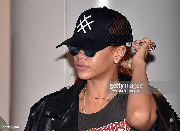 Pop star Rihanna arrives at the international airport in Narita suburban Tokyo on June 15 2015 Rihanna who hails from Barbados and is a resident of...