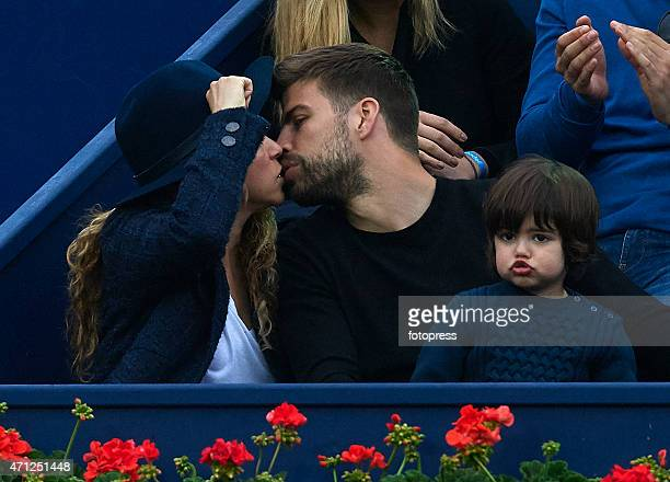Pop star Shakira and husband Gerard Pique of FC Barcelona kisses in the final during day seven of the Barcelona Open Banc Sabadell at the Real Club...