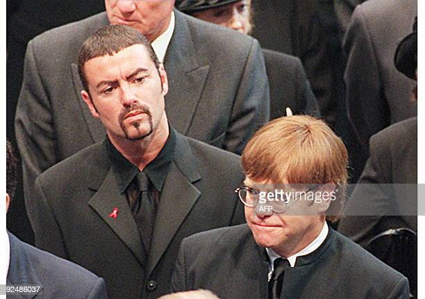 Pop stars George Michael and Elton John leave Westminster Abbey after the funeral service 06 September of Diana Princess of Wales The Princess was...
