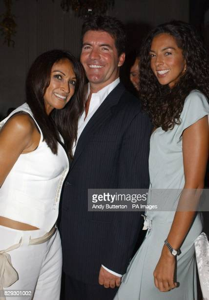 Pop svengali Simon Cowell poses with his exgirlfriend Jackie St Clair and his current girlfriend Terri Seymour during the launch of his new band Il...
