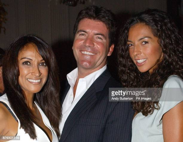 Pop svengali Simon Cowell's with exgirlfriend Jackie St Clair and current girlfriend Terri Seymour during the launch of his new band Il Divo at the...