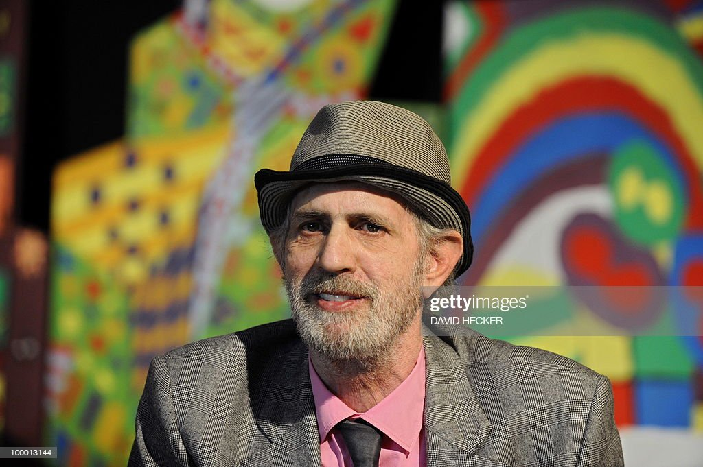 US pop-artist James Rizzi gives an interview during a press preview of the exhibition 'Rizzi's World' on May 20, 2010 in Bremen, northern Germany. From May 21 to July 4, 2010, the Messehallen Bremen present a retrospective with more than 1,200 works of the artist.