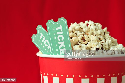 Popcorn Bag And Movie Ticket On Red Background : Foto stock