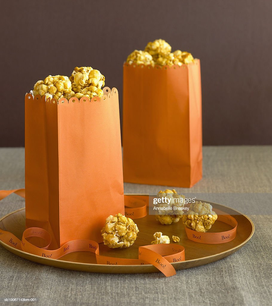 Popcorn balls in paper bags : Stock Photo