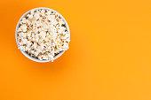 Popcorn on orange background
