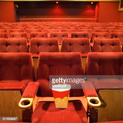 Popcorn on the seat in a cinema : Stock Photo