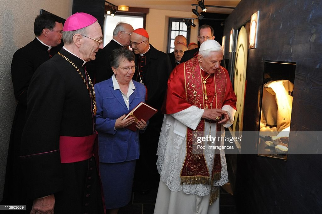 Pope Benedict visite the Cachot of Bernadette Subirous in Lourdes, France On September 13, 2008-<a gi-track='captionPersonalityLinkClicked' href=/galleries/search?phrase=Pope+Benedict+XVI&family=editorial&specificpeople=201771 ng-click='$event.stopPropagation()'>Pope Benedict XVI</a> (Right) accompanied by Bishop Jacques Perrier (L) of Tarbes and Lourdes and Sister Michele Coeurderoy (Center) visits the Cachot, an abandoned prison cell where <a gi-track='captionPersonalityLinkClicked' href=/galleries/search?phrase=Bernadette+Soubirous&family=editorial&specificpeople=251912 ng-click='$event.stopPropagation()'>Bernadette Soubirous</a> lived with her family, in Lourdes. The Pope will commemorate here the 150th anniversary of the Vatican-recognized apparitions of the Virgin Mary to peasant girl <a gi-track='captionPersonalityLinkClicked' href=/galleries/search?phrase=Bernadette+Soubirous&family=editorial&specificpeople=251912 ng-click='$event.stopPropagation()'>Bernadette Soubirous</a>.