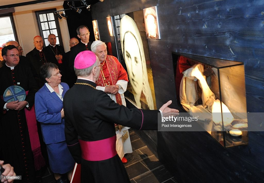 Pope Benedict visite the Cachot of Bernadette Subirous in Lourdes, France On September 13, 2008-<a gi-track='captionPersonalityLinkClicked' href=/galleries/search?phrase=Pope+Benedict+XVI&family=editorial&specificpeople=201771 ng-click='$event.stopPropagation()'>Pope Benedict XVI</a> (Right) accompanied by Bishop Jacques Perrier (front Center) of Tarbes and Lourdes and Sister Michele Coeurderoy (2nd Left) visits the Cachot, an abandoned prison cell where <a gi-track='captionPersonalityLinkClicked' href=/galleries/search?phrase=Bernadette+Soubirous&family=editorial&specificpeople=251912 ng-click='$event.stopPropagation()'>Bernadette Soubirous</a> lived with her family, in Lourdes. The Pope will commemorate here the 150th anniversary of the Vatican-recognized apparitions of the Virgin Mary to peasant girl <a gi-track='captionPersonalityLinkClicked' href=/galleries/search?phrase=Bernadette+Soubirous&family=editorial&specificpeople=251912 ng-click='$event.stopPropagation()'>Bernadette Soubirous</a>.