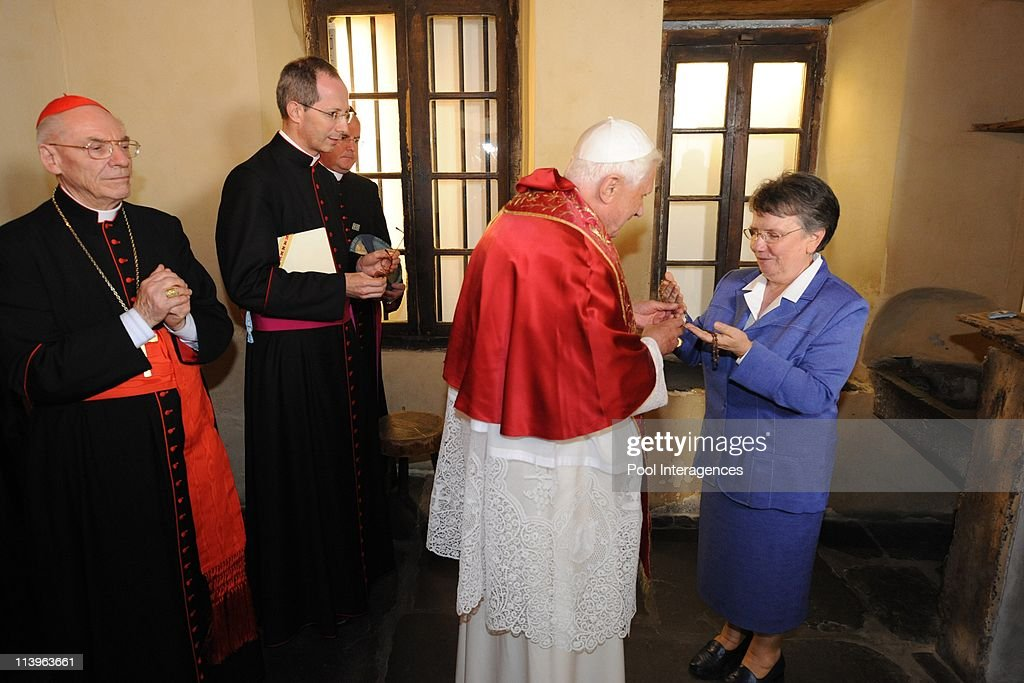 Pope Benedict visite the Cachot of Bernadette Subirous in Lourdes, France On September 13, 2008-Sister Michele Coeurderoy (Right) shows <a gi-track='captionPersonalityLinkClicked' href=/galleries/search?phrase=Bernadette+Soubirous&family=editorial&specificpeople=251912 ng-click='$event.stopPropagation()'>Bernadette Soubirous</a>' rosary to <a gi-track='captionPersonalityLinkClicked' href=/galleries/search?phrase=Pope+Benedict+XVI&family=editorial&specificpeople=201771 ng-click='$event.stopPropagation()'>Pope Benedict XVI</a> (Center) as he visits the Cachot, an abandoned prison cell where <a gi-track='captionPersonalityLinkClicked' href=/galleries/search?phrase=Bernadette+Soubirous&family=editorial&specificpeople=251912 ng-click='$event.stopPropagation()'>Bernadette Soubirous</a> lived with her family, in Lourdes. The Pope will commemorate here the 150th anniversary of the Vatican-recognized apparitions of the Virgin Mary to peasant girl <a gi-track='captionPersonalityLinkClicked' href=/galleries/search?phrase=Bernadette+Soubirous&family=editorial&specificpeople=251912 ng-click='$event.stopPropagation()'>Bernadette Soubirous</a>.