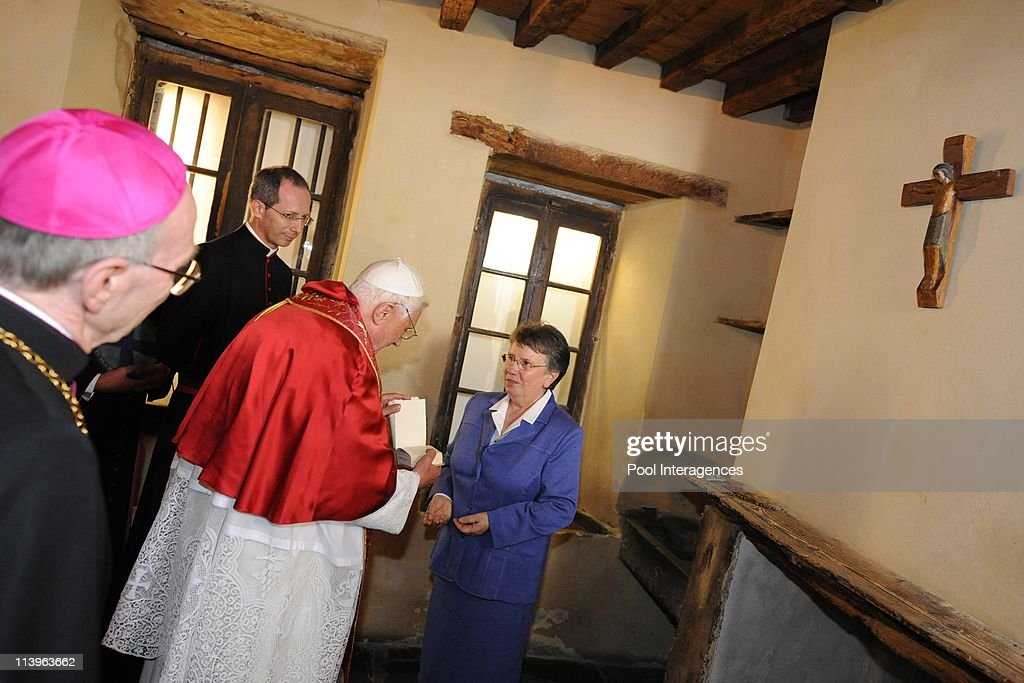 Pope Benedict visite the Cachot of Bernadette Subirous in Lourdes, France On September 13, 2008-Sister Michele Coeurderoy (Right) shows <a gi-track='captionPersonalityLinkClicked' href=/galleries/search?phrase=Bernadette+Soubirous&family=editorial&specificpeople=251912 ng-click='$event.stopPropagation()'>Bernadette Soubirous</a>' notes to <a gi-track='captionPersonalityLinkClicked' href=/galleries/search?phrase=Pope+Benedict+XVI&family=editorial&specificpeople=201771 ng-click='$event.stopPropagation()'>Pope Benedict XVI</a> (Center) as he visits the Cachot, an abandoned prison cell where <a gi-track='captionPersonalityLinkClicked' href=/galleries/search?phrase=Bernadette+Soubirous&family=editorial&specificpeople=251912 ng-click='$event.stopPropagation()'>Bernadette Soubirous</a> lived with her family, in Lourdes. The Pope will commemorate here the 150th anniversary of the Vatican-recognized apparitions of the Virgin Mary to peasant girl <a gi-track='captionPersonalityLinkClicked' href=/galleries/search?phrase=Bernadette+Soubirous&family=editorial&specificpeople=251912 ng-click='$event.stopPropagation()'>Bernadette Soubirous</a>.