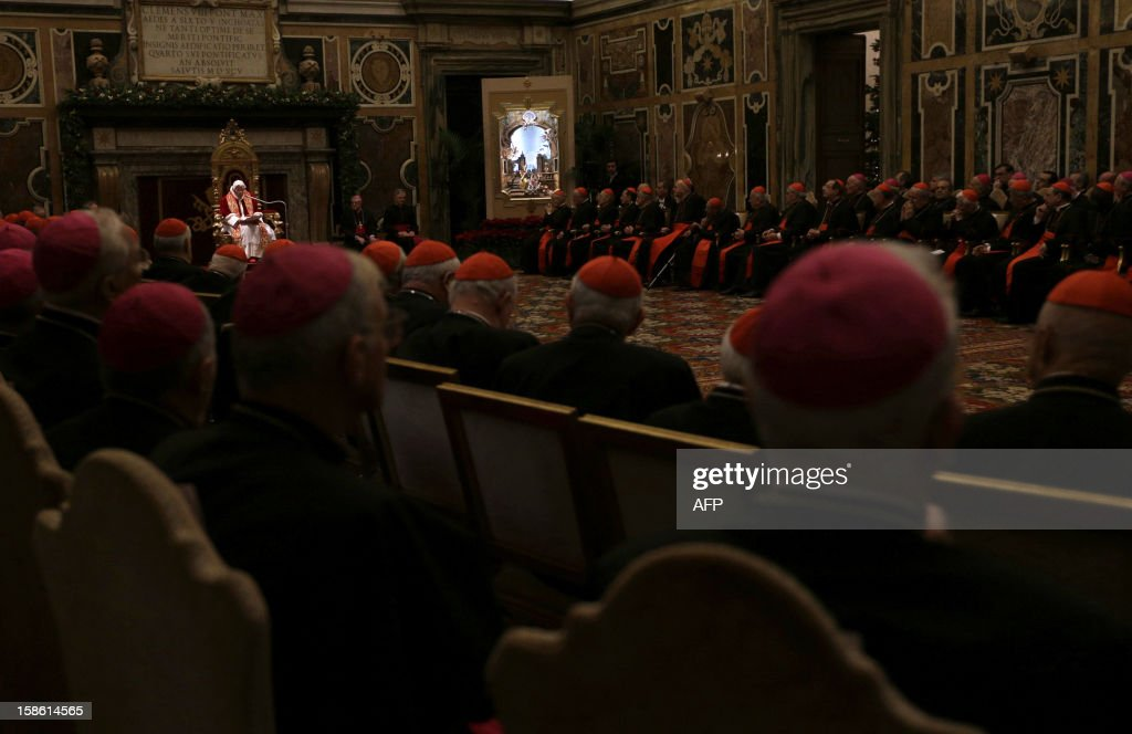 Pope Benedict XVI (C) addresses his greetings to the Roman curia in the Clementine hall at the Vatican on December 21, 2012 at the Vatican.