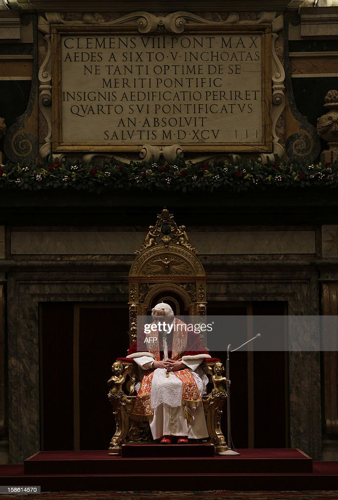 Pope Benedict XVI addresses his greetings to the Roman curia in the Clementine hall at the Vatican on December 21, 2012 at the Vatican. AFP PHOTO / POOL / ALESSANDRA TARANTINO