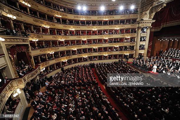 Pope Benedict XVI addresses the audience of La Scala theater Orchestra during a concert in Milan on June 1 2012 during the 7th World Meeting of...