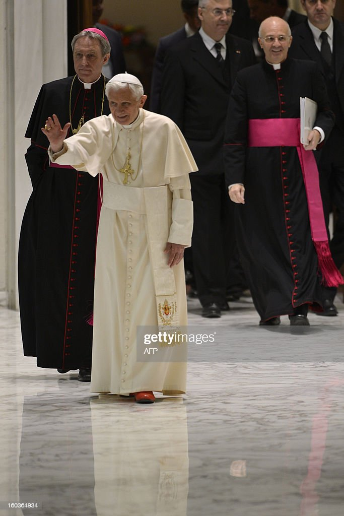 Pope Benedict XVI (R) and his personal secretary Georg Gaenswein arrive for the weekly general audience on January 30, 2013 at the Paul VI hall at the Vatican.