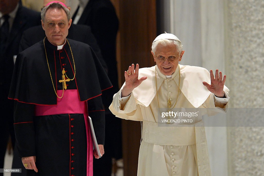 Pope Benedict XVI (R) and his personal secretary Georg Gaenswein arrive for the weekly general audience on February 6, 2013 at the Paul VI hall at the Vatican.