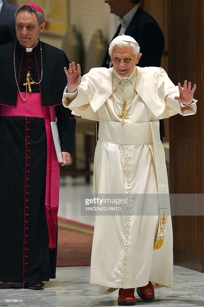 Pope Benedict XVI (R) and his personal secretary Georg Gaenswein arrive for the weekly general audience on February 06, 2013 at the Paul VI hall at the Vatican.