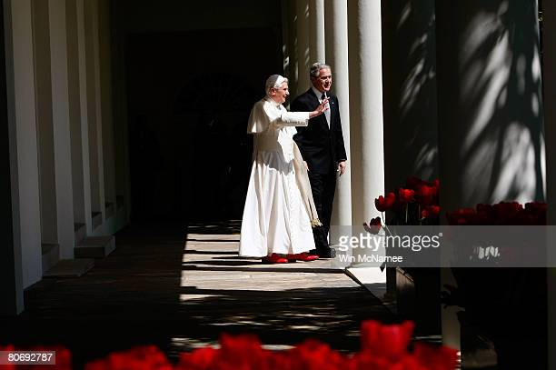 Pope Benedict XVI and US President George W Bush wave as they walk along the Collonade following an arrival ceremony on the South Lawn at the White...