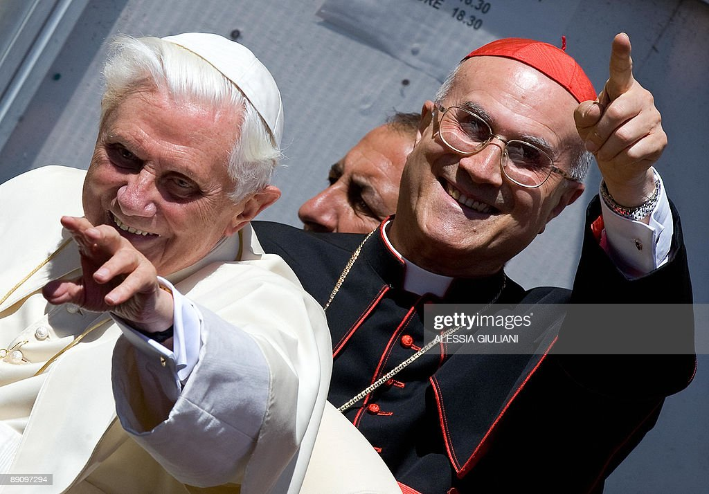 Pope Benedict XVI and Vatican Secretary of State Cardinal Tarcisio Bertone wave as they leave after the Sunday Angelus prayer on July 19 2009 in...