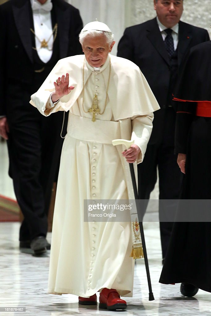 <a gi-track='captionPersonalityLinkClicked' href=/galleries/search?phrase=Pope+Benedict+XVI&family=editorial&specificpeople=201771 ng-click='$event.stopPropagation()'>Pope Benedict XVI</a> arrives at the Paul VI Hall for a meeting with parish priests of Rome's diocese on February 14, 2013 in Vatican City, Vatican. The Pontiff will hold his last weekly public audience on February 27 at St Peter's Square after announcing his resignation earlier this week. (Photo by Franco Origlia/Getty Images).