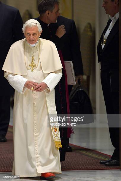 Pope Benedict XVI arrives for his weekly general audience on December 12 2012 at the Paul VI hall at the Vatican AFP PHOTO / VINCENZO PINTO
