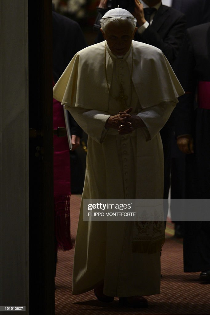 Pope Benedict XVI arrives for his weekly general audience on February 13, 2013 at the Paul VI hall at the Vatican. Pope Benedict XVI made his first public appearance Wednesday since the shock announcement of his resignation, sticking with his schedule by presiding over his weekly general audience.