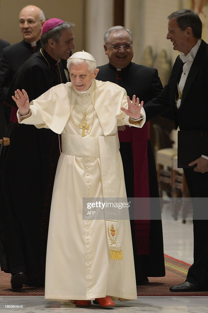 Pope Benedict XVI arrives for the weekly general audience on January 30, 2013 at the Paul VI hall at the Vatican. AFP PHOTO / ANDREAS SOLARO