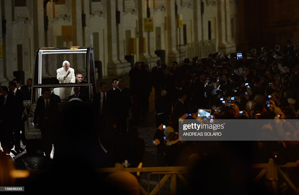 Pope Benedict XVI arrives in front of the nativity crib in Saint Peter's Square after celebrating the Vespers and Te Deum prayers in Saint Peter's Basilica at the Vatican on December 31, 2012.