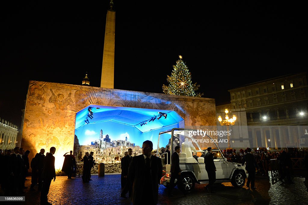 Pope Benedict XVI arrives to pray in front of the nativity crib in Saint Peter's Square after celebrating the Vespers and Te Deum prayers in Saint Peter's Basilica at the Vatican on December 31, 2012. AFP PHOTO / ANDREAS SOLARO
