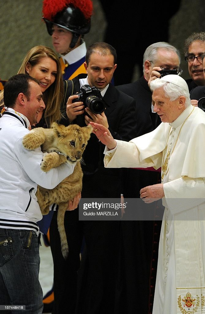 <a gi-track='captionPersonalityLinkClicked' href=/galleries/search?phrase=Pope+Benedict+XVI&family=editorial&specificpeople=201771 ng-click='$event.stopPropagation()'>Pope Benedict XVI</a> attends a special audience for circus artists at the Paul VI Hall on December 1, 2012 in the Vatican City, Vatican. Thousands of Circus professionals, operators of amusement parks and fairs, street performers, artists, and puppeteers, and folk groups gathered in Rome to participate in a two-day pilgrimage organised for travelling performers. The 85-year-old Benedict paid particular attention to a pair of lion cubs that were brought up to him during a greeting with the Pontiff in the Paul the VI Hall.