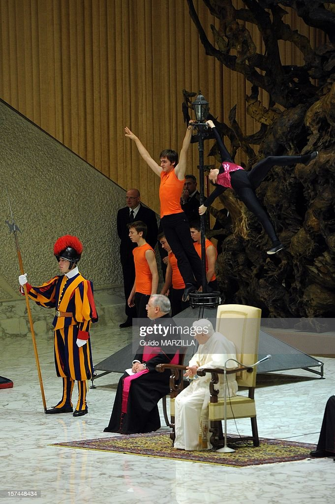 Pope Benedict XVI attends a special audience for circus artists at the Paul VI Hall on December 1, 2012 in the Vatican City, Vatican. Thousands of Circus professionals, operators of amusement parks and fairs, street performers, artists, and puppeteers, and folk groups gathered in Rome to participate in a two-day pilgrimage organised for travelling performers. The 85-year-old Benedict paid particular attention to a pair of lion cubs that were brought up to him during a greeting with the Pontiff in the Paul the VI Hall.
