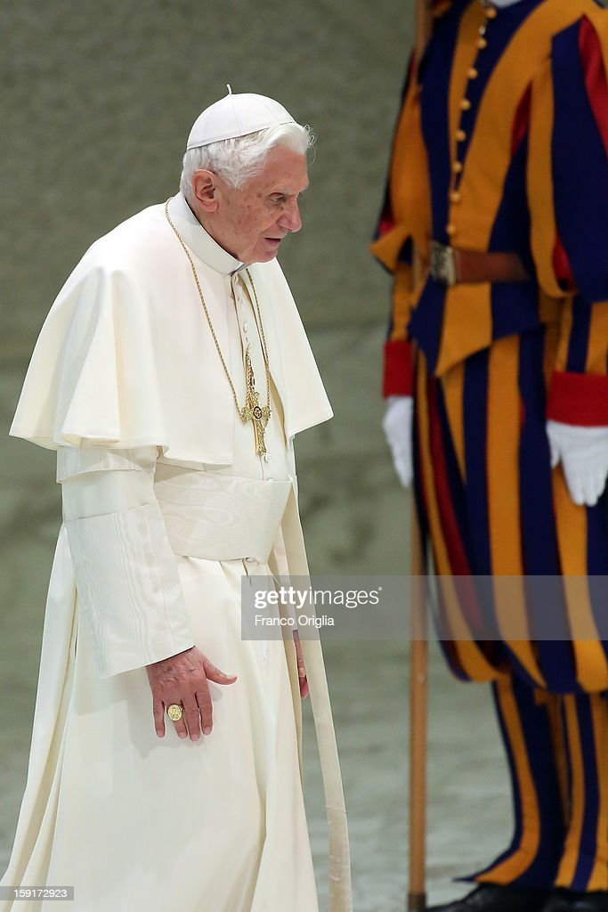 <a gi-track='captionPersonalityLinkClicked' href=/galleries/search?phrase=Pope+Benedict+XVI&family=editorial&specificpeople=201771 ng-click='$event.stopPropagation()'>Pope Benedict XVI</a> (C) attends his blessing at the end of his weekly audience at the Paul VI Hall on January 9, 2013 in Vatican City, Vatican. The Pontiff gave the catechesis dedicated to the Year of Faith, during his regularly scheduled Wednesday general audience.