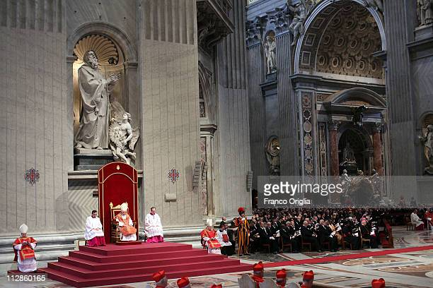 Pope Benedict XVI attends the celebration of the Lord's Passion at St Peter's Basilica on April 22 2011 in Vatican City Vatican