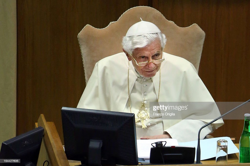 <a gi-track='captionPersonalityLinkClicked' href=/galleries/search?phrase=Pope+Benedict+XVI&family=editorial&specificpeople=201771 ng-click='$event.stopPropagation()'>Pope Benedict XVI</a> attends the Synod of Bishops for The New Evangelization for the Transmission of the Christian Faith at the Synod hall on October 19, 2012 in Vatican City, Vatican. The Synod of Bishops was established by Pope Paul Vl in 1965 after The Second Vatican Council to advise the Pope in growing the faith throughout the world.