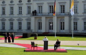 Pope Benedict XVI beside of German President Christian Wulff delivers a speech in front of assembled guests in the gardens at Schloss Bellevue...