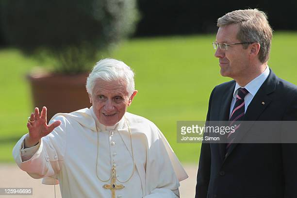 Pope Benedict XVI beside of German President Christian Wulff waves to assembled guests in the gardens at Schloss Bellevue presidential palace on...