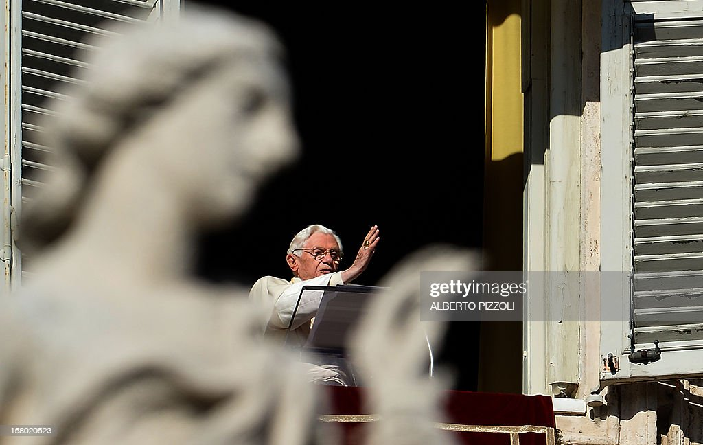 Pope Benedict XVI blesses faithful as he leads the Angelus prayer from a window of his apartments on December 9, 2012 at the Vatican.
