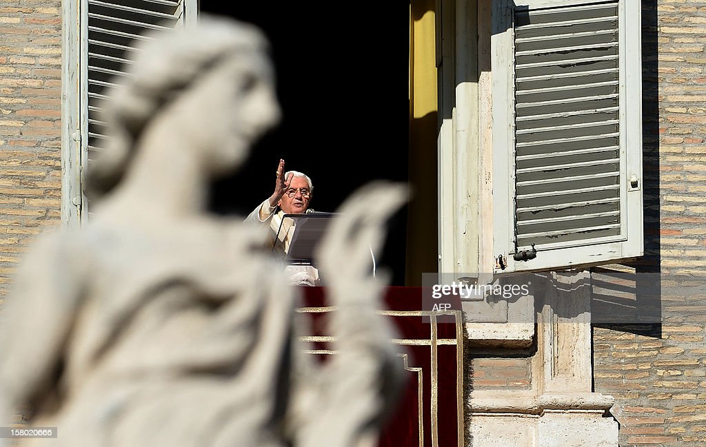 Pope Benedict XVI blesses faithful as he leads the Angelus prayer from a window of his apartments on December 9, 2012 at the Vatican. AFP PHOTO / ALBERTO PIZZOLI