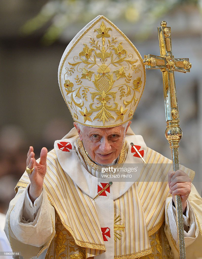 Pope Benedict XVI blesses faithful at the end of the Epiphany mass in St. Peter's Basilica in Vatican City on January 6, 2013.