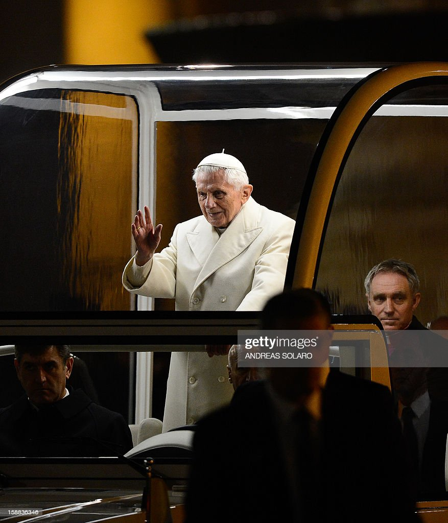 Pope Benedict XVI blesses the audience as he arrives in front of the nativity crib in Saint Peter's Square after celebrating the Vespers and Te Deum prayers in Saint Peter's Basilica at the Vatican on December 31, 2012.