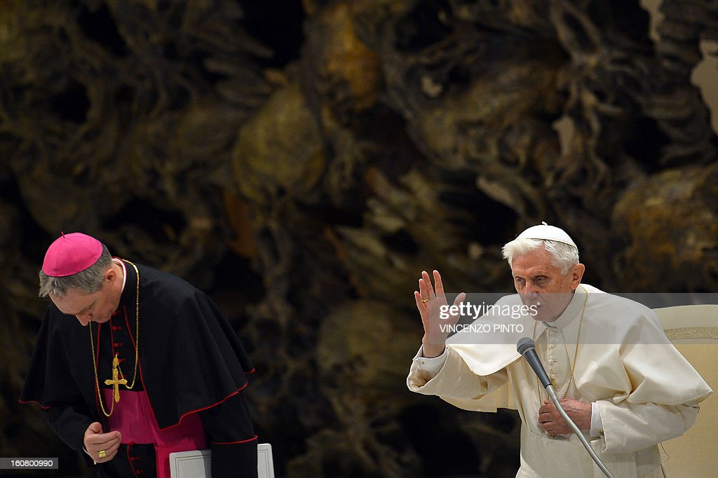Pope Benedict XVI blesses the crowd during the weekly general audience on February 6, 2013 at the Paul VI hall at the Vatican. AFP PHOTO / VINCENZO PINTO