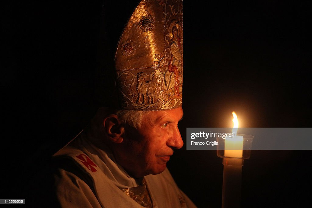 Pope Benedict XVI carries the Paschal candle as he leads the Ceremony of the Light during the Holy Saturday Easter vigil mass at St. Peter's Basilica on April 7, 2012 in Vatican City, Vatican. The Pope will lead Easter Sunday Mass celebrating the resurrection of Jesus tomorrow in St. Peter's Square.